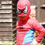 Child dressed like spiderman